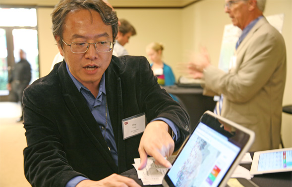 SDSU geography professor Ming-Hsiang Tsou follows disease-related keywords on Twitter in order to identify outbreaks of influenza. Photo: Whitney Mullen