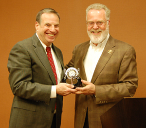 Congressman Bob Filner, left, accepts the AHE Public Service Award from SDSU President Stephen Weber.