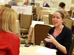 An aspiring writer speaks with an agent at the SDSU Writers' Conference.