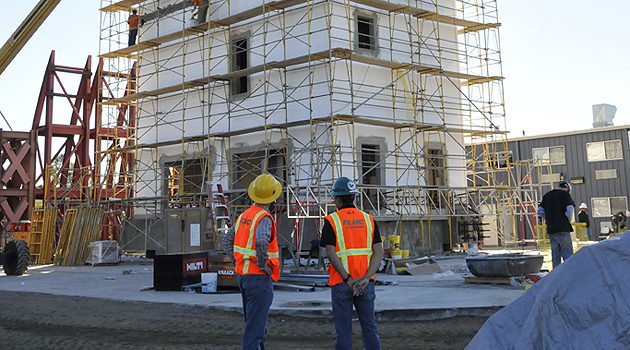 Ken Walsh and Eli Espino observe construction activity at the Englekirk Center