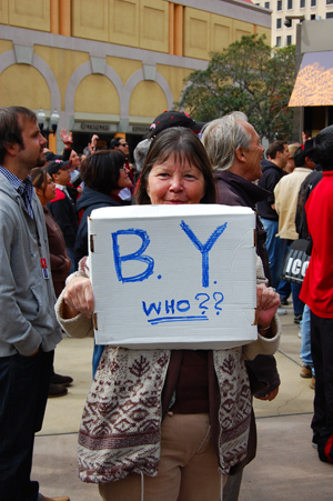 An SDSU fan asks an important question at the rally held downtown Friday.