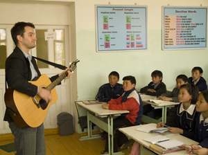 Education volunteer Jacob Knight teaches his students English through songs he wrote with fellow Peace Corps volunteers.