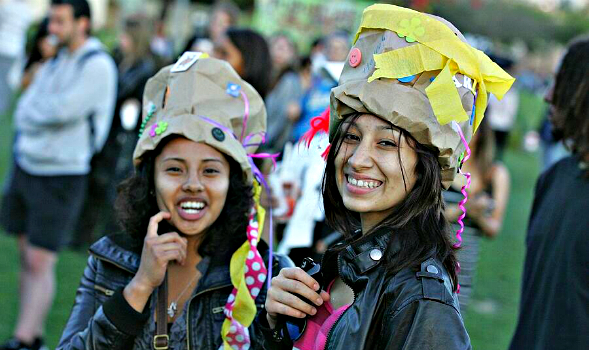 Two students enjoy GreenFest 2011 by making hats out of paper bags.