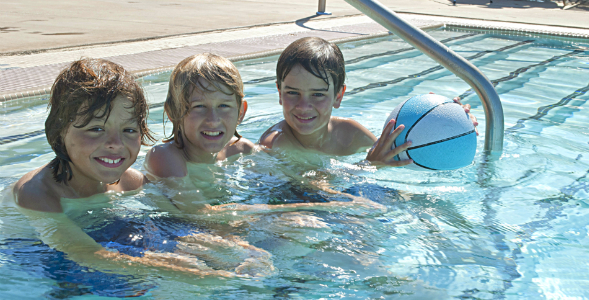 Three boys enjoy some time in the Aztec Aquaplex recreation pool.