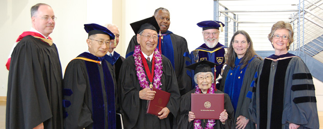 Carl Yoshimine (left, holding degree) and June Junko Kushino (right, holding degree)