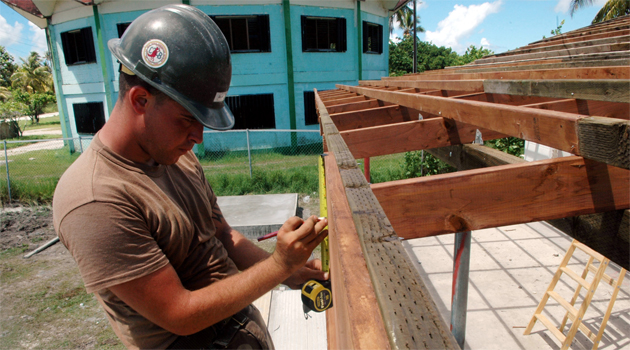 Steven Cline, with U.S. Navy Mobile Construction Battalion 133, makes adjustments for the reconstruction of Mwan Elementary School during a Pacific Partnership engineering civic action program.