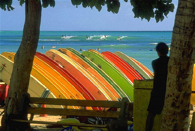 Waikiki Beach in Hawaii is a popular surfing destination.