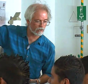 Chemistry professor Andrew Cooksy works with students at a local high school.