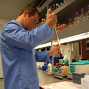 A student researcher in the BioScience Center pipettes a sample.