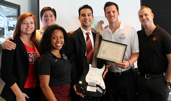 Associated Students accepts the award -- an electric guitar -- for collecting the most donations. From left: Christina Brown, Tom Rivera, Channelle McNutt, Eric Anderberg, Rob O' Keefe, Matt Cecil.