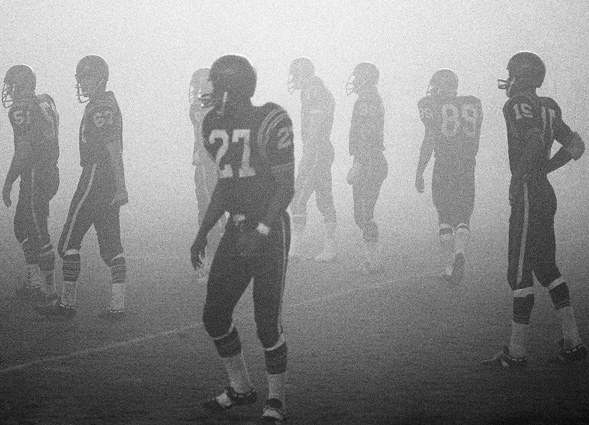 SDSU football players battle foggy conditions during a 1968 game against San Jose State.