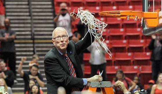 Steve fisher cuts down the net
