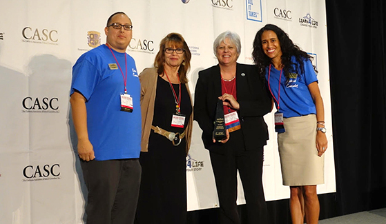 Trish Hatch (second from the right) accepts the the inaugural Counselor Educator of the Year Award from the California Association of School Counselors. (Credit: CASC)