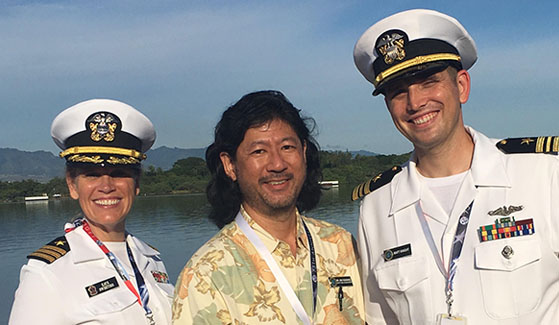 Kaye Sweetser (left) worked alongside former PAO students Jon Yoshishige (center) and Lt. Cmdr. Matt Knight at the Pearl Harbor commemoration in December.