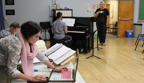 Aimee Holland (left) works at a rehearsal for the production of