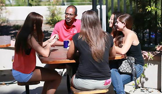 SDSU professor Paul Minifee speaks to students at a residence hall.