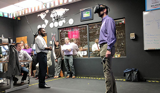 "University of Bristol roboticist Jonathan Rossiter (right) walks a virtual plank in SDSU professor Harsimran ""Sim"" Baweja's lab. (Photo: Michael Price)"