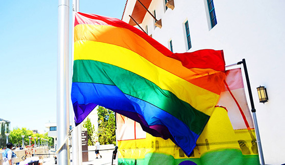 The Pride Flag symbolizes the diversity of sexual orientations and gender identities in the SDSU community.