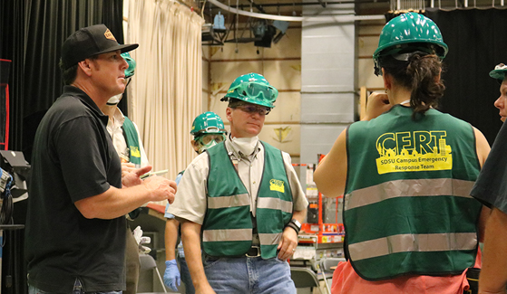 SDSU CERT members discuss procedure during a practice drill.