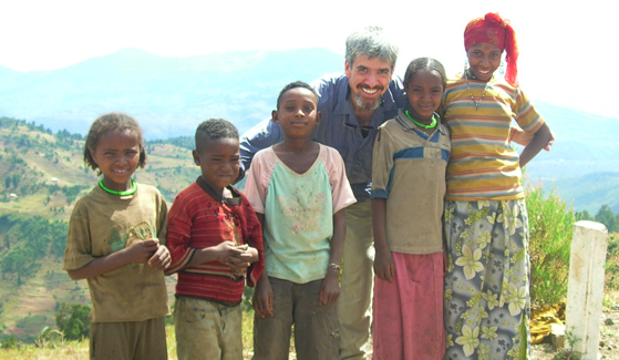 SDSU geography professor Stuart Aitken (center) with a family in Ethiopia, on the road to Djibouti.