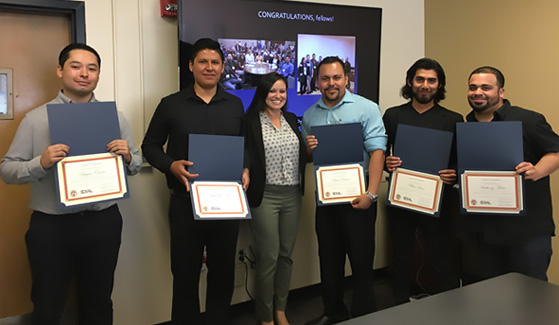 Left to right: Bryan Osorio, Alejandro Arias, SDSU education professor Marissa Vasquez, Oscar Duran, Ulises Leal and Anthony Mota