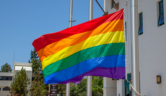 A photo from the 10th annual Rainbow Flag Raising Ceremony at SDSU in 2017.