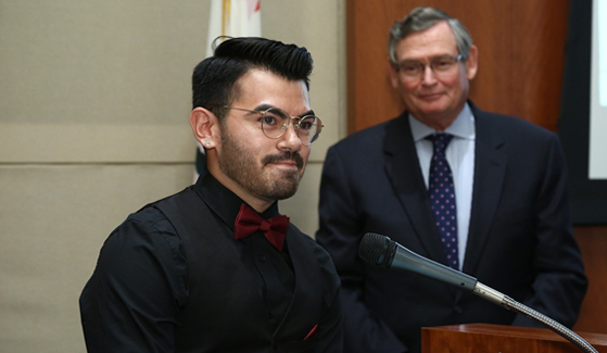 Manuel Gonzales IV with CSU Chancellor Timothy P. White in the background (Credit: CSU)