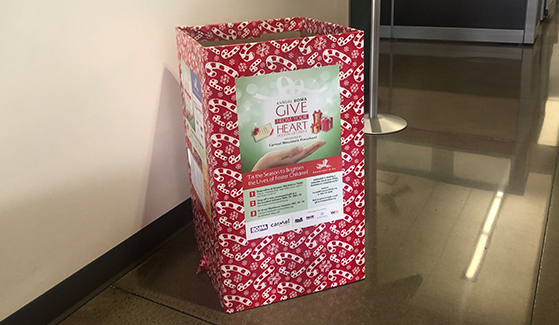 Donation bins for the annual Give From Your Heart Holiday Gift Drive are located across campus.