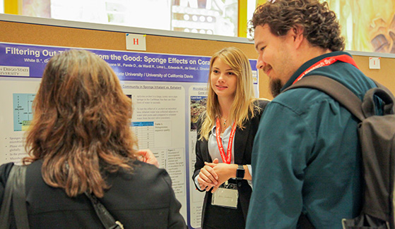 An SDSU student presents her work at last year