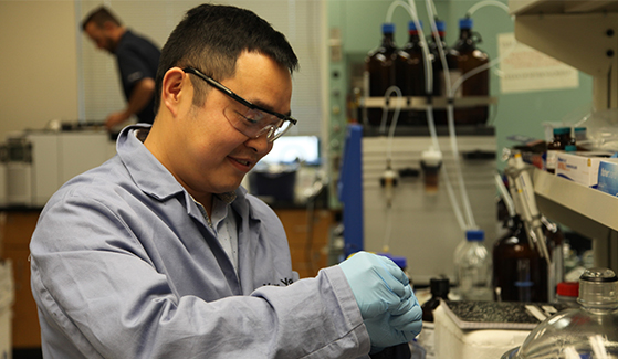 Chemistry professor Yong Yan in his lab studying the photocatalyst perovskite.