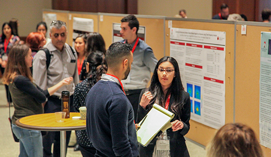 SDSU student shares her research at annual Student Research Symposium.