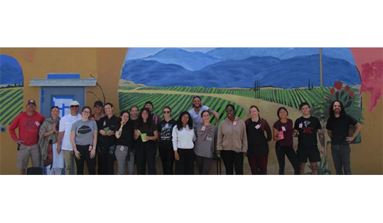 Inmates at the Donovan Correctional Facility joined students from the San Diego State University School of Art and Design to paint a mural in a prison yard.