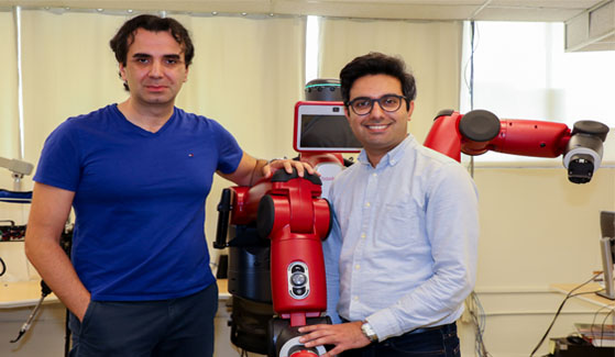 Robotics researcher and assistant professor Peiman N. Mousavi with his student Mostafa Bagheri and the robot they worked on. Robotics researcher and assistant professor Peiman N. Mousavi (left) with his student Mostafa Bagheri and the robot they worked on