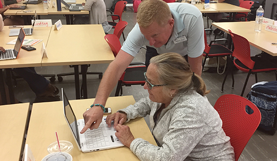 Cajon Valley School District teacher Val Donaldson received guidance from instructor Matthew Evans at the Coding for Teachers workshop.
