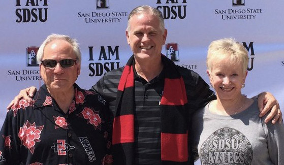 From left to right: Gerry Kirk ('65, '73), SDSU men's basketball head coach Brian Dutcher and Patsy Kirk ('69, '75)