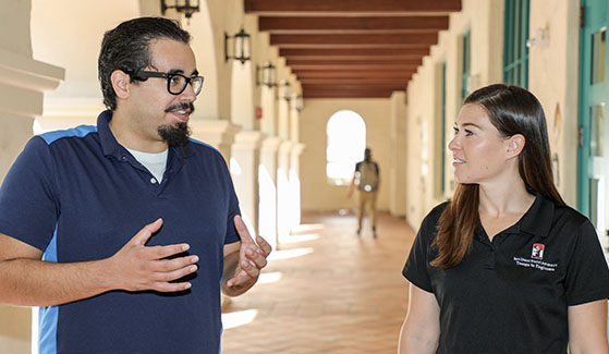 Engineering major Tyler Perez, who received the 2019 CSU Trustees Award for Outstanding Achievement, speaks with his mentor Brittany Field. Photo: Scott Hargrove for SDSU