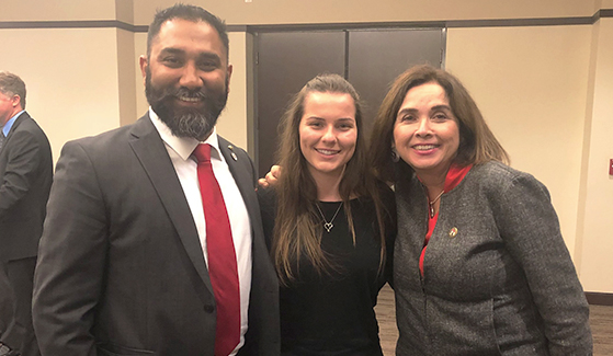 Katie Dillon (center) with her mentor and clinical neuroscientist Harsimran Baweja (left) and SDSU President Adela de la Torre at a Campanile Foundation event.