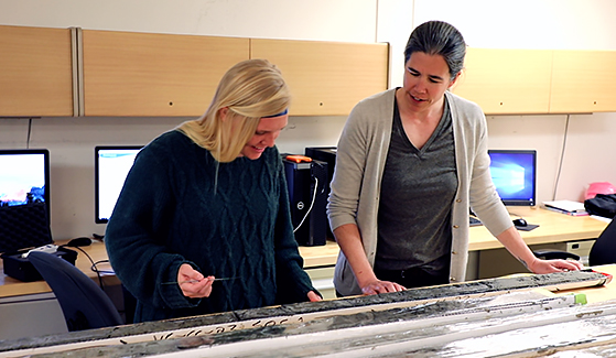 SDSU researcher Jillian Maloney (right) studies sediment cores in her San Diego State University geology lab.