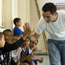 Volunteer David Martinez celebrates a soccer goal with his students in Romania.