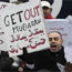 "Egyptian protesters with signs saying ""Get Out Mubarak"""