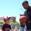 DJ Gay signs a basketball for a young fan