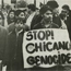 "archived photo of Chicano holding ""Stop Chicano Genocide"" sign"