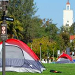 Tents dot the grassy knolls of Campanile Walkway