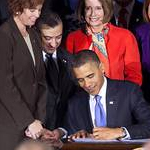 President Barack Obama signs the repeal of the military