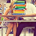 A couple shares a moment in SDSU's Love Library. Photo courtesy of joielala photographie.