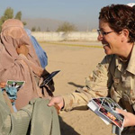 A female soldier speaks with an Afghan woman. Photo courtesy of Afghanistan International Security Assistance Force, NATO