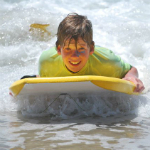 boy boogie boarding at Mission Bay Aquatic Center