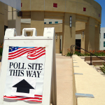 "Sign saying ""Poll Site This Way"" outside of Alumni Center"