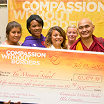 Lama Tenzin Dhonden, the Personal Peace Emissary for His Holiness the Dalai Lama and students from the Monarch School.