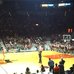 SDSU student Craig Horlbeck sinks a half court shot at midnight madness event.